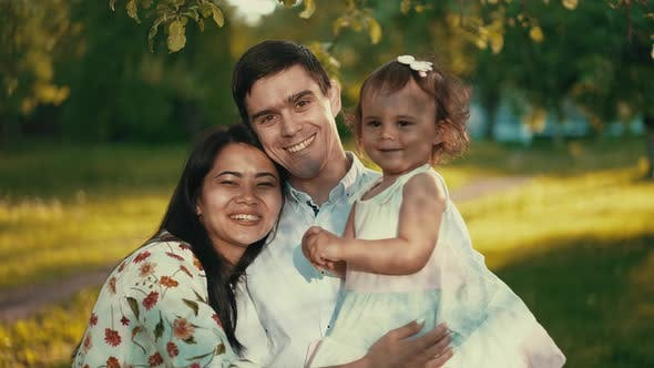 Happy Young Family on Nature