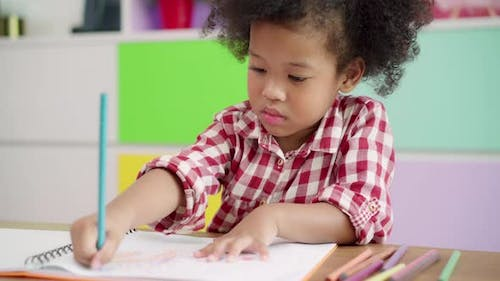 African kids drawing and do homework in classroom.