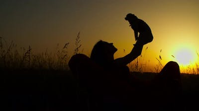 Loving Dog Owner Holding Doggy in Evening Glow