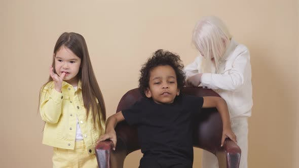 Friendly Diverse Kids Play Hairdressers.