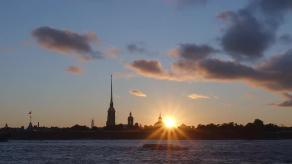 Sun and silhouette of Peter and Paul Fortress in the sunset - St. Petersburg, Russia