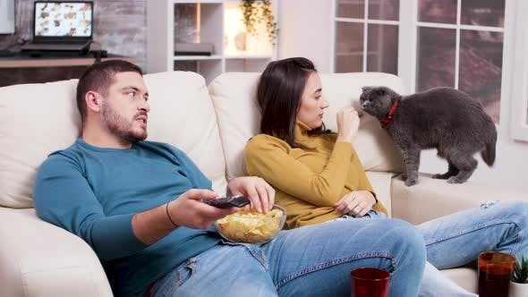 Couple Relaxing Watching a Movie on Tv