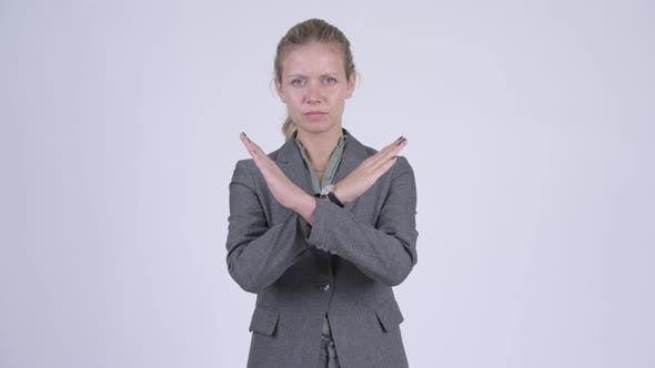 Thumbnail for Young Serious Blonde Businesswoman Showing Stop Gesture Using Arms