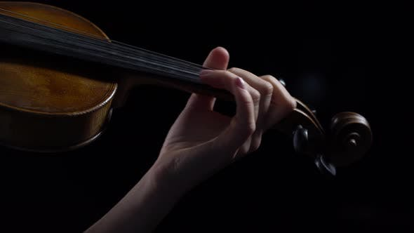 Thumbnail for Girl Fingering the Strings Playing on a Violin. Close Up. Black Background