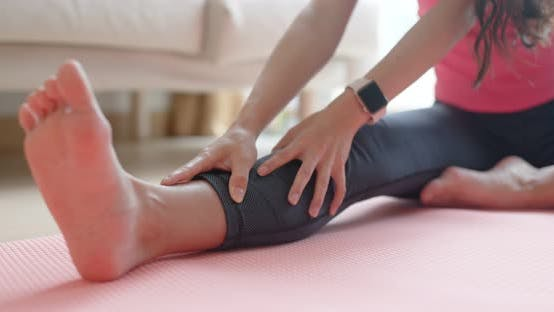Cover Image for Woman stretching legs at home