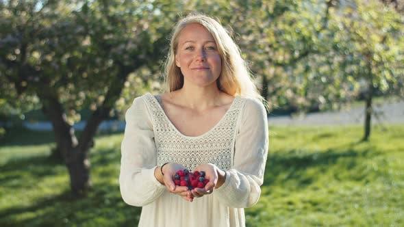Thumbnail for Beautiful Vegan Holding Homegrown Fruits