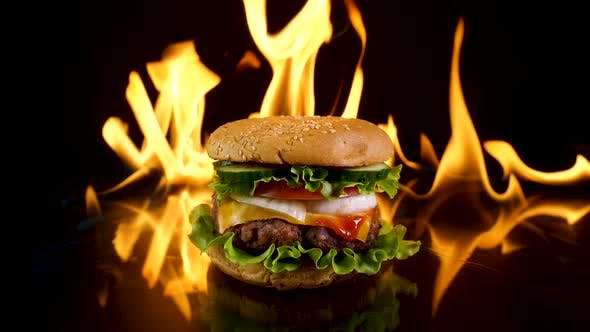 Delicious Burger on the Background of Fire