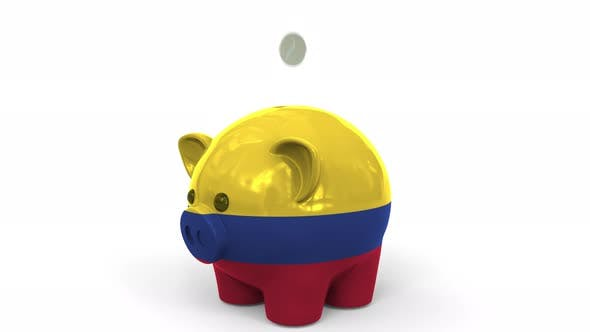 Thumbnail for Coins Fall Into Piggy Bank Painted with Flag of Colombia