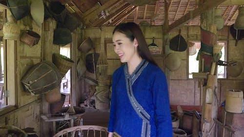 Asian Woman In Wooden Farm House