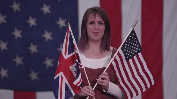 Thumbnail for Woman holding up the Union Jack Flag and American Flag