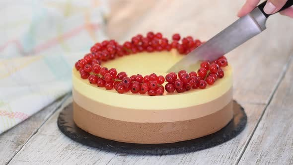 Thumbnail for Cutting a Triple Chocolate Mousse Cake with Red Currant