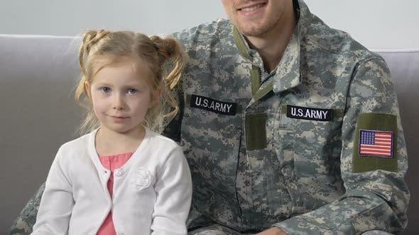 American Serviceman Hugging Cute Daughter Holding National Flag, Patriotism
