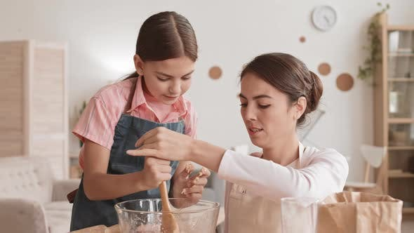 Mother and Daughter Making Dough Together