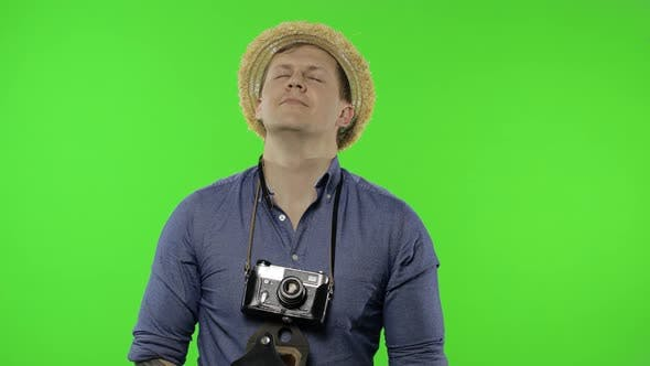 Thumbnail for Portrait of Man Tourist Photographer Relaxing on Vacation. Chroma Key