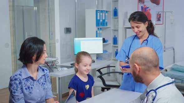 Thumbnail for Doctor and Nurse Talking with Child Patient