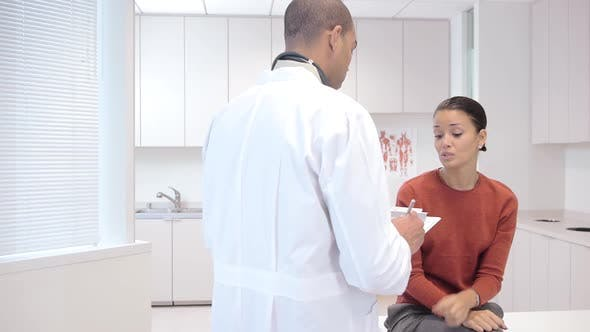 Thumbnail for Doctor consulting patient in exam room