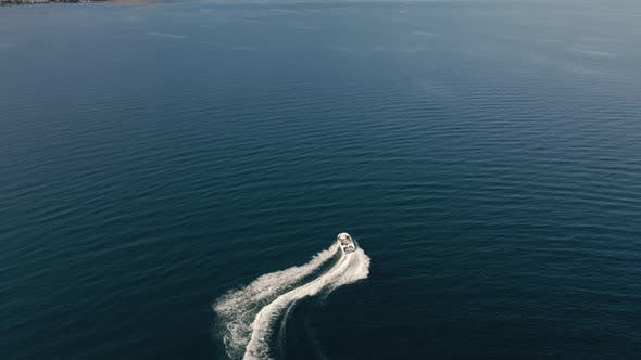 Thumbnail for Drone View Of Speedboat Making Quick Turns On Vibrant Blue Water