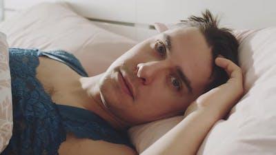Portrait of Transgender Man in Bed