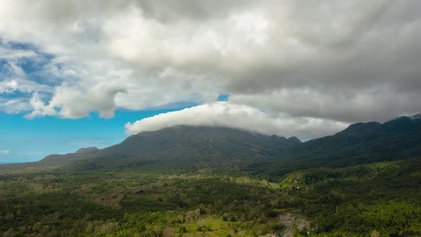 Thumbnail for Mountains Covered with Rainforest and Clouds, Timelapse