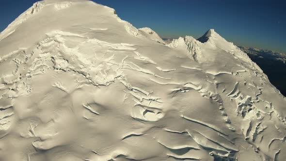 Cover Image for Flying Over Top Peak Of Mountain Mt Baker Washington Cascade Mountains Incredible Extreme