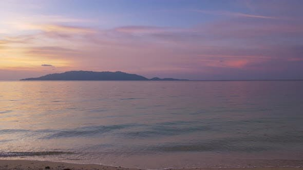 Thumbnail for Time lapse tropical beach and sea at sunset. Colorful dramatic sky at dusk