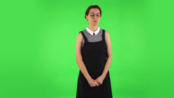 Thumbnail for Funny Girl in Round Glasses Is Very Offended and Looking Away, Green Screen