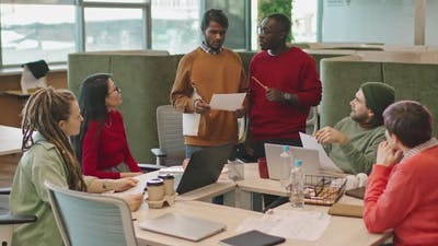 Cheerful Businessmen Conducting Meeting