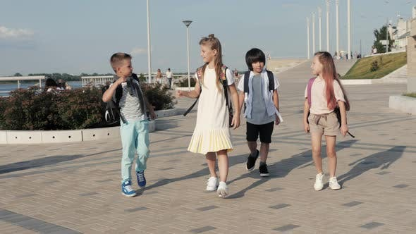 Thumbnail for Infant School Kids Walking To School with Backpacks and Give High Five To Eachother.