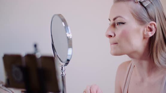 Cover Image for Woman Doing Makeup - Woman Beauty Concept