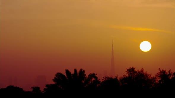 Thumbnail for Sun Setting Behind Skyscraper