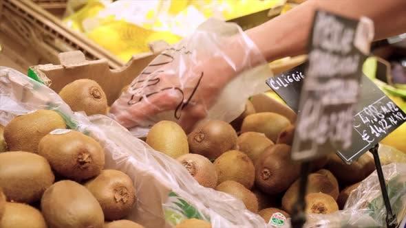 Thumbnail for Picking Kiwi Fruit in the Market