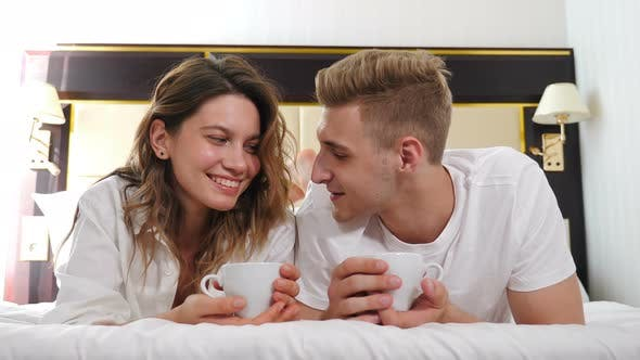 Thumbnail for Portrait of Young Couple Lying on Bed and Smiling at Camera. Happy Relationship. Romantic Scene in