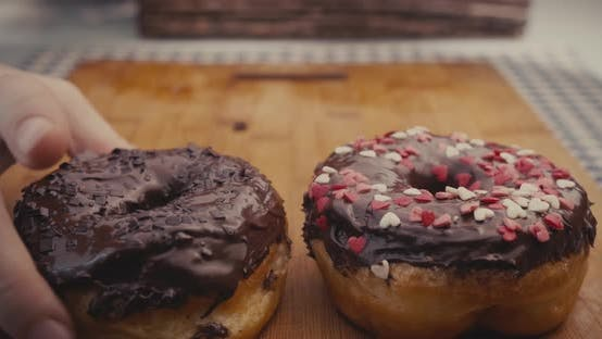 Thumbnail for Male and Female Hands Taking All the Donuts from a Plate