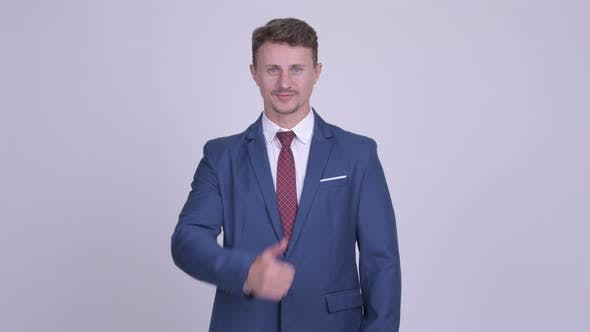 Thumbnail for Happy Bearded Businessman Giving Thumbs Up