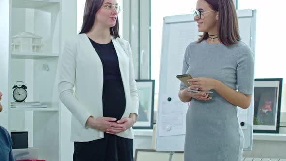 Thumbnail for Pregnant Businesswoman Introducing Employee