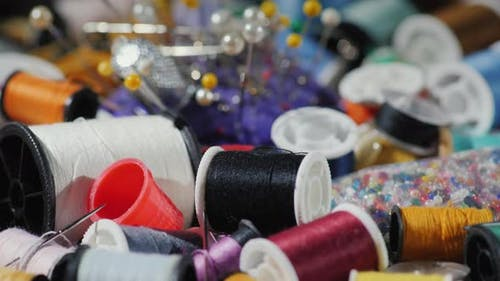 The Art of Needlework. Background with Threads, Needles and Other Accessories for Embroidery