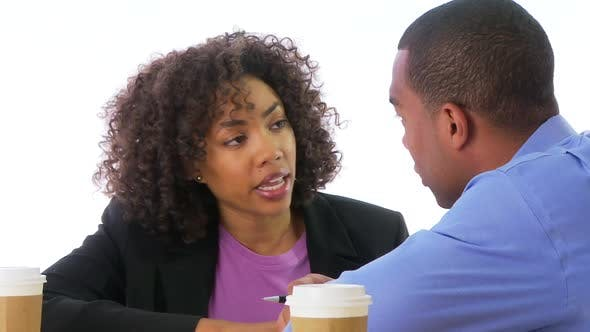 Two business people talking face to face