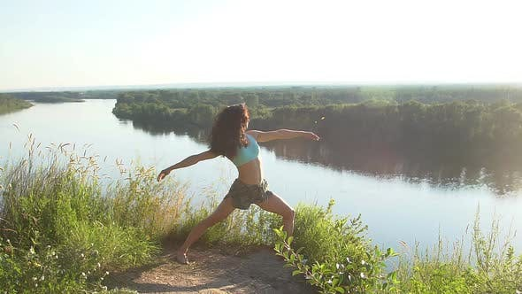 Thumbnail for Girl Practices Yoga Outdoors on an Incredible Clifftop, Slow Motion