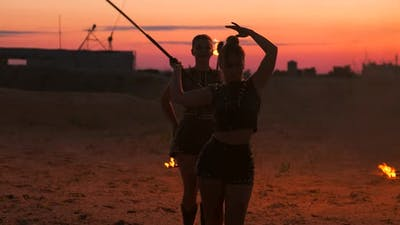 Professional Dancers Women Make a Fire Show and Pyrotechnic Performance at the Festival with Burning