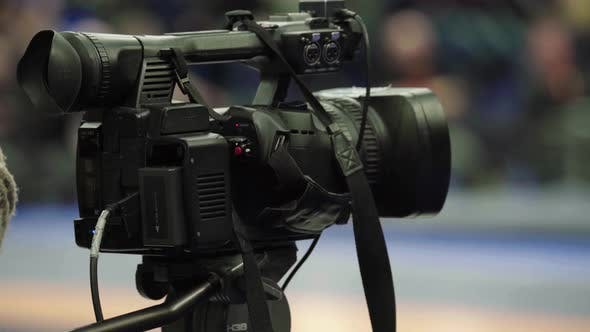 Cameraman with a Camera in Wrestling Competitions. Close-up.