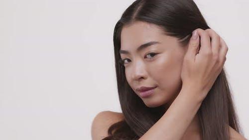 Young Beautiful Asian Girl Looking at Camera