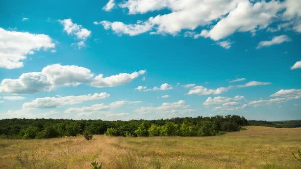 Thumbnail for Moving Clouds in Blue Sky Above Landscape Fields. Timelapse. Amazing Rural Valley. Ukraine