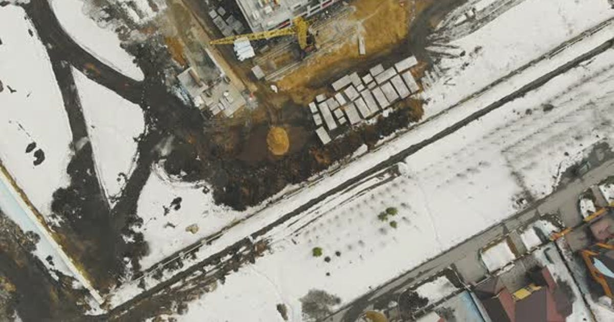 Abandoned Industrial Site Covered with Thick Snow Layer