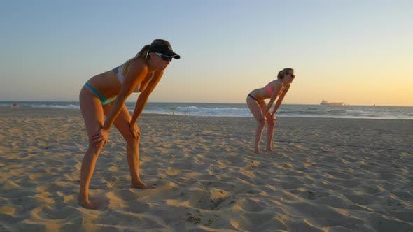 Thumbnail for Women beach volleyball team play at sunset.