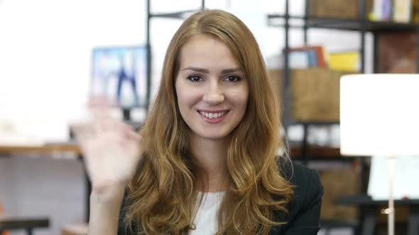 Hello by Waving Hand by Girl at Work in Office, Warm Welcome