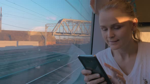 Thumbnail for In Saint-Petersburg, Russia in Train Rides Young Girl and Looking Out the Window