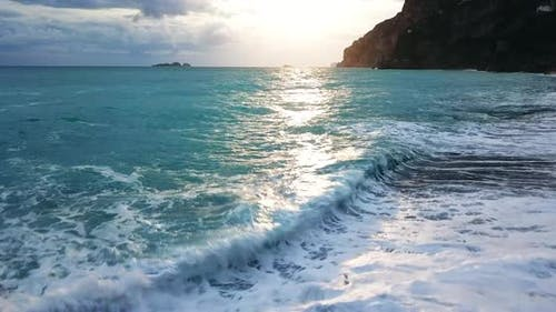Sea waves in sunlight, Positano, Italy