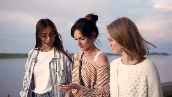 Thumbnail for Casual Group of Girls Using Smart Phone Voice Recognition While Walking.