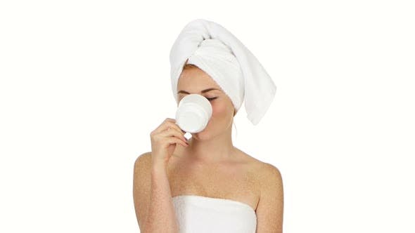 Thumbnail for Girl Is Drinking Coffee. Her Eyes Are Closed with Pleasure and She Has Towel on Her Head. Close Up