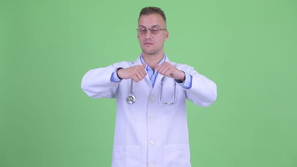 Thumbnail for Confused Man Doctor Choosing Between Thumbs Up and Thumbs Down